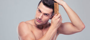 Picture of a man combing hair